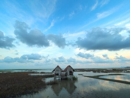 twin house in Talay Noi (littlesea) in Pattalung Province,Thailand, A beautiful location such a sennetic place many people go there to take photo of this house because it is look like a location in a movie or novel.