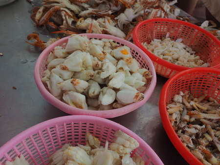 peeling shell boiled crab by man before sell to market restaurant and supermarket. They got crabs from fishermanboat then boil it before peel it.