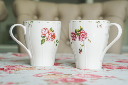 cup on a floral tablecloth
