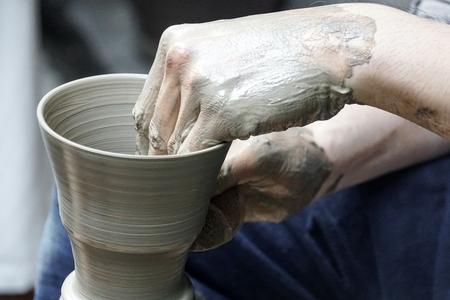 artisan hands making clay pot handmade pottery workshop