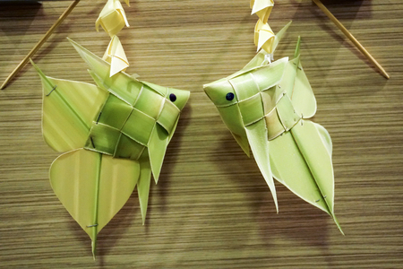 thai style palm leaf carp fish mobile handicraft