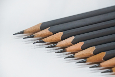 sharp grey pencils on white table background Imagens