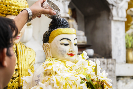 Buddha image statue at Shwedagon Pagoda temple, Myanmar