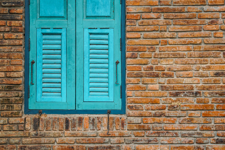 blue window brick wall exterior Stock Photo