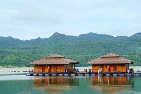 wooden floating raft house resort by mountain Kanchanaburi, Thailand Editorial