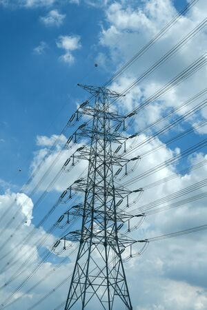 high voltage power electric pole wire blue cloudy sky