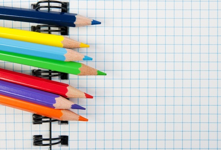 Colored pencils and a notebook Stock Photo