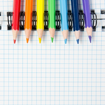organizer page: Colored pencils and a notebook Stock Photo