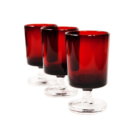 three dark-red glasses isolated on white background