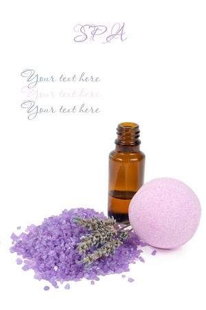 Bottle of lavender essential oil and spa salt bomb isolated on white background with the sample text  photo