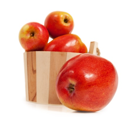 Apples in a wooden basket  isolated on white background