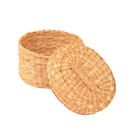 Handmade braided basket with a lid isolated on white background