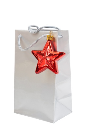 silver gift bag with a red star isolated on white