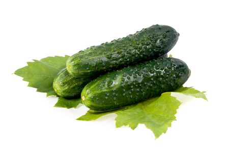 Cucumbers with green leaves isolated on white background  Stock Photo