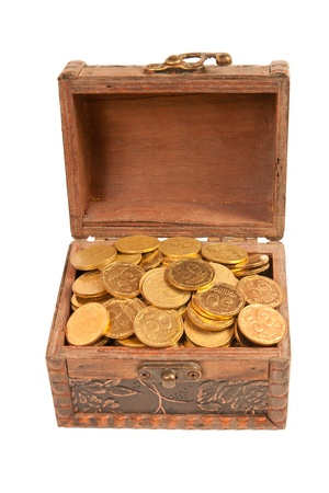 an old trunk with shiny coins isolated on white background Stock Photo