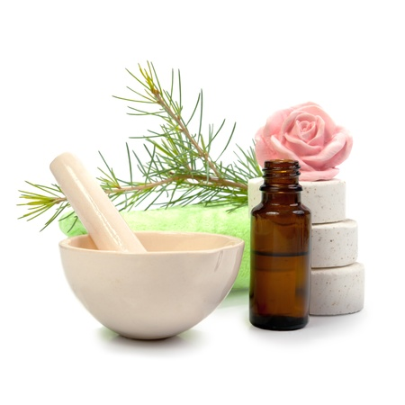 Bottle of fir tree essential oil and spa salt tablets isolated on white background