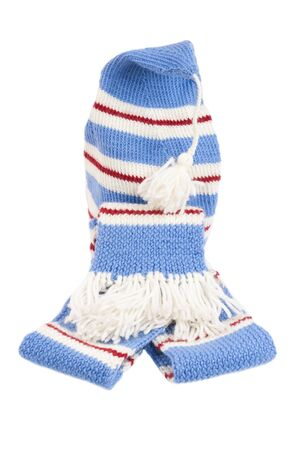 Warm knitted scarf and hat with stripes isolated on white background  photo