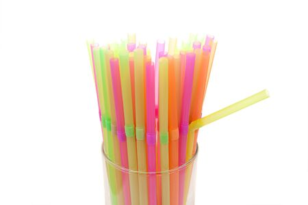 Drinking colorful  straws  on a white background  photo