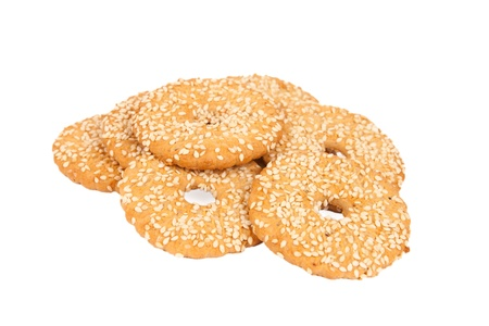 Round cookies with sesame seeds isolated on white background