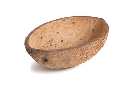 box of coconut halves isolated on white background  photo