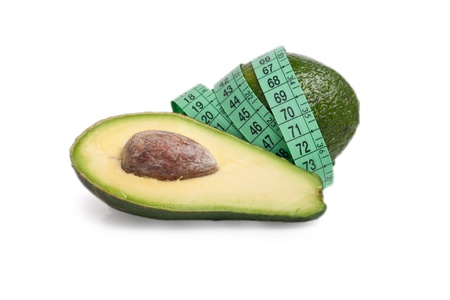 Avocado with a tape measure isolated on white background, concept for healthy eating  photo