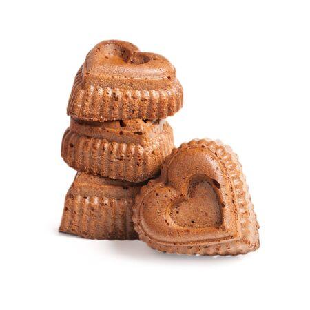 decoracion de pasteles: Muffins en forma de corazón aislado en un fondo blanco Foto de archivo
