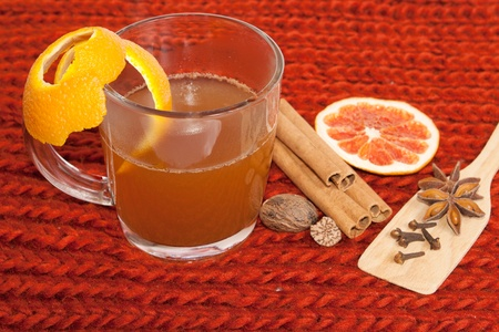 Glass of mulled wine on woven background  Stock Photo
