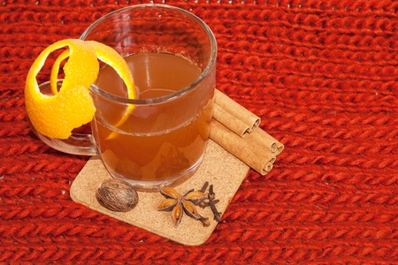 Glass of mulled wine on woven background  photo