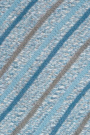 motley multicolored wool knitted background closeup