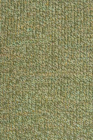 lint:  motley multicolored wool knitted background closeup