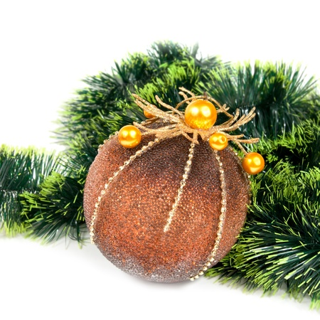 Christmas background with a ball and a pine tinsel on white