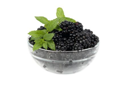 Blackberry with mint leaves in a bowl isolated on white background Stock Photo