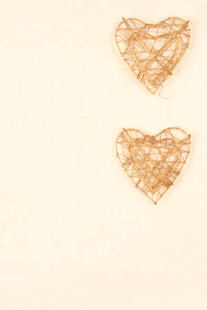 background with two hearts on gold with copy space for your text