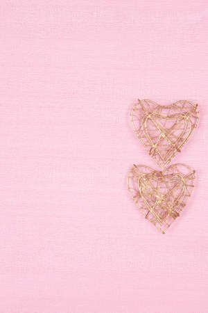 background with two hearts on pink with copy space for your text