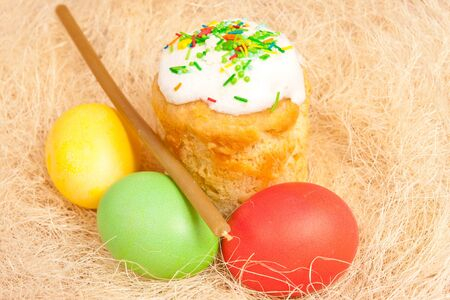 Easter cake and eggs on the bright background  photo