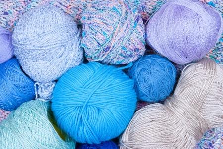 multicolored bright balls of yarn closeup