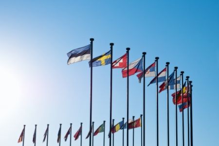 International Flags against blue sky background Stock Photo