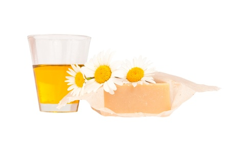 handmade soap, natural oil and  daisies  isolated on white background Stock Photo