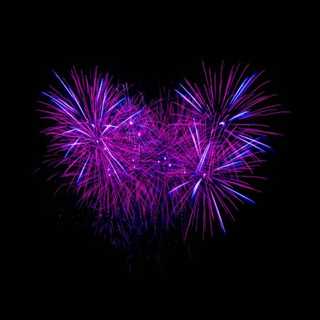 Colorful heart fireworks on the black sky background  Stock Photo