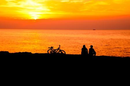 man and woman at sunset sea closeup Stock Photo
