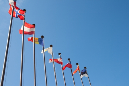 International Flags against blue sky Stock Photo