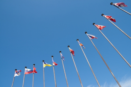 International Flags against blue sky Stock Photo