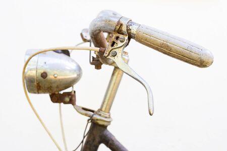 Retro styled bike handle isolated on a white background Stock Photo