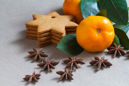 Species, tangerine and bakery on the table photo