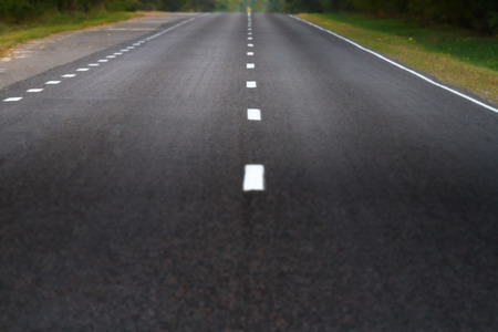 Filtered ant tinted picture of a blured abstract asphalt road