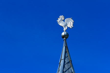 spire: Weathervane made of tin on the top of a spire.