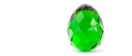 cutglass: Old easter decoration made of green glass on a white background