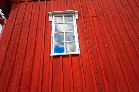 wall clouds: Red wall and a window with clouds reflected, background. Stock Photo