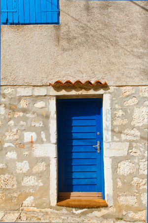 mediterranian: The stoney wall, blue door and the window, mediterranian architecture.