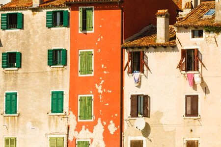 mediterranian: The colored walls and the windows with shutters, mediterranian architecture.